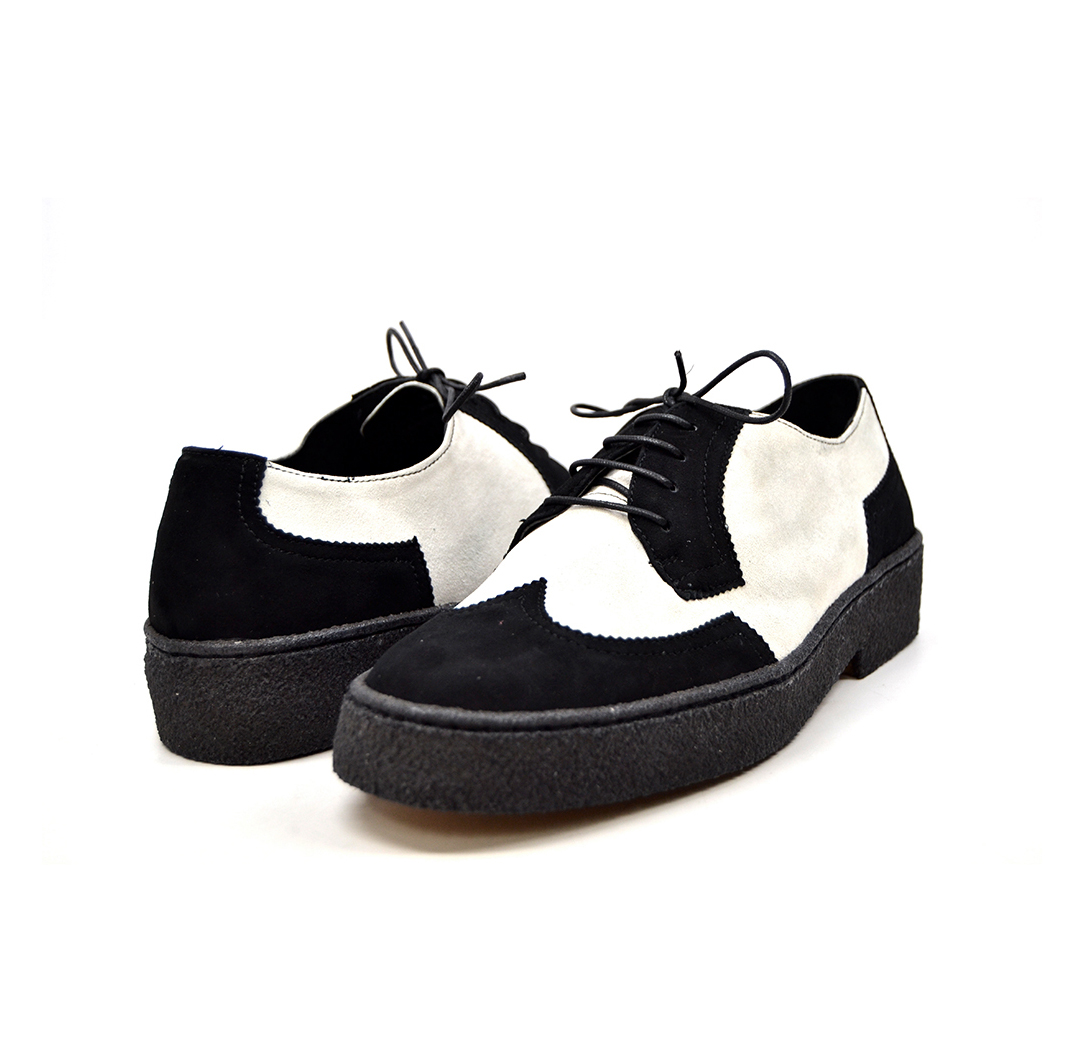 black and white wingtip shoes